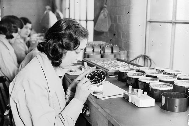 The clock is ticking: women paint luminous dials in 1932