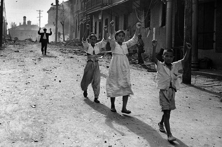 The Korean war was the single greatest calamity of the period. Residents of Inchon surrender to American troops in 1950