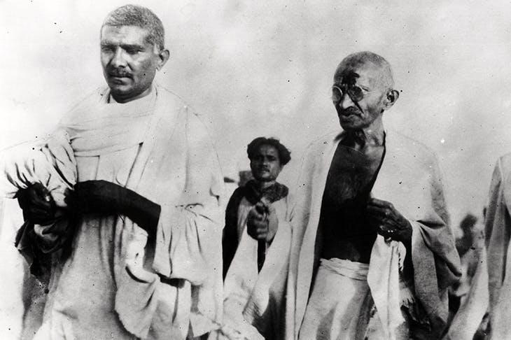Gandhi strides forth on the Salt March in 1930, protesting against the government's monopoly of salt production
