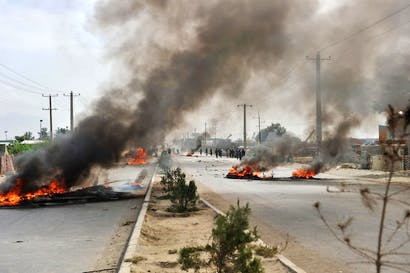 Barricades of tyres burn on Jalalabad Road in Kabul during an anti-US protest. Picture: Getty.