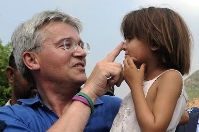 Andrew Mitchell in happier days as the charity wristband-clad International Development Secretary. Picture: Getty