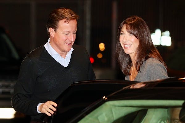 David Cameron arrives with his wife Samantha in Birmingham for the Conservative party conference. Picture: Getty.