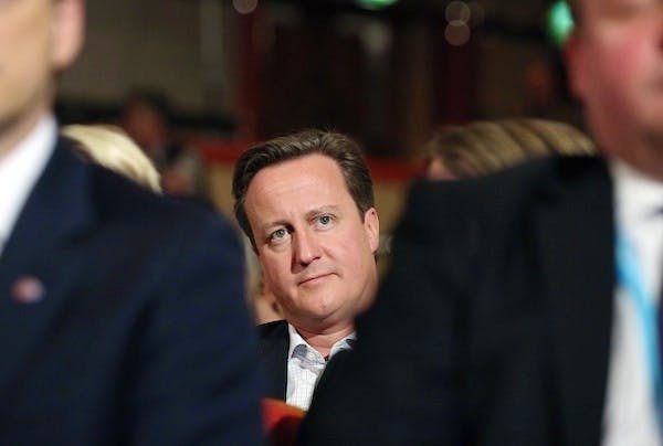 David Cameron watches proceedings in the conference hall in Birmingham. Picture: Getty