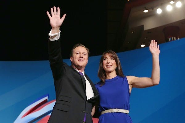 David Cameron and his wife Samantha take applause from the Conservative party conference. Picture: Getty