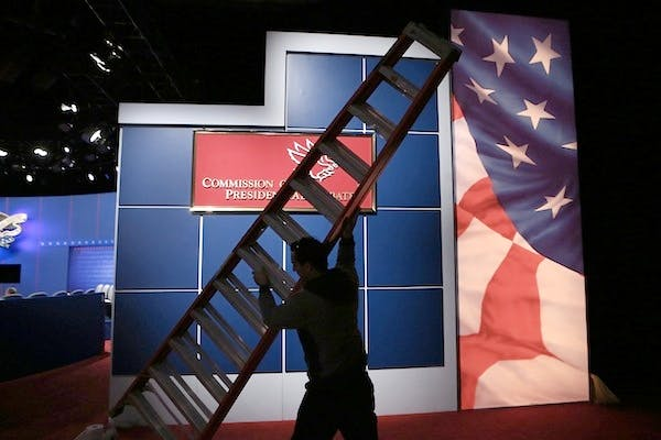 The set is prepared for tonight's presidential debate between Barack Obama and Mitt Romney. Picture: Getty