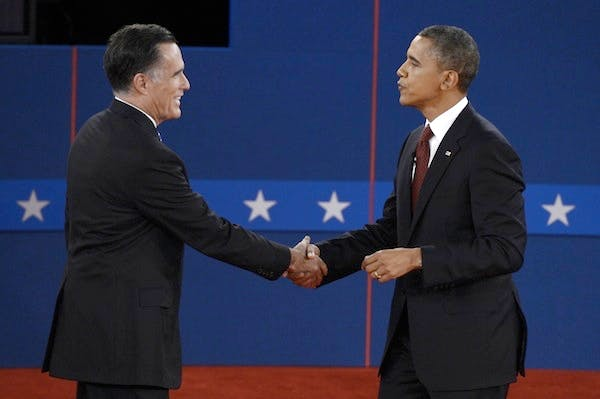 Barack Obama and Mitt Romney shake hands after the second presidential debate last night. Picture: Getty
