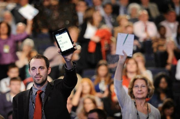 Delegates try to attract Ed Miliband's attention at the Labour party conference. Picture: Press Association.