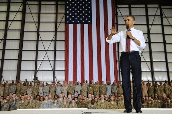 Barack Obama addresses troops in Afghanistan earlier this year. Picture: Getty