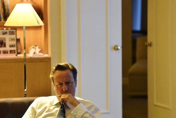 David Cameron listens during a private meeting with pressure group 'Hacked Off' at the Conservative Party conference. Today he will respond to the Leveson report. Picture: Getty