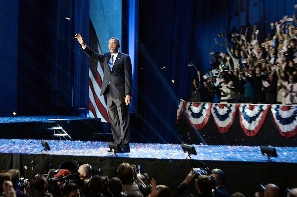 President Obama waves to his supporters after being re-elected to the White House. Picture: Getty