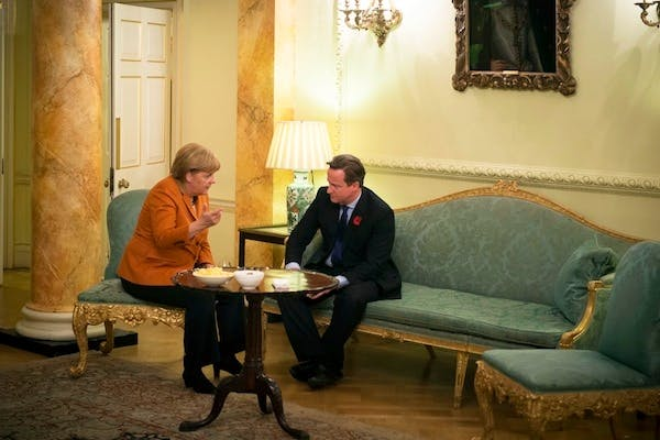 David Cameron and Angela Merkel discussing the EU budget on Wednesday. Picture: Getty