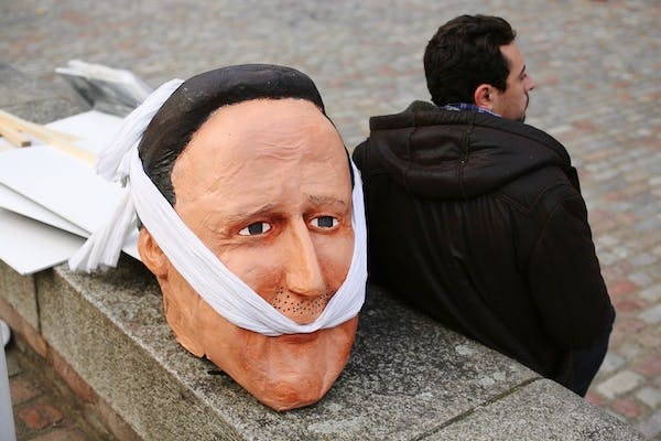 A papier mache head of David Cameron used by protesters outside the Leveson Inquiry press conference. Picture: Getty