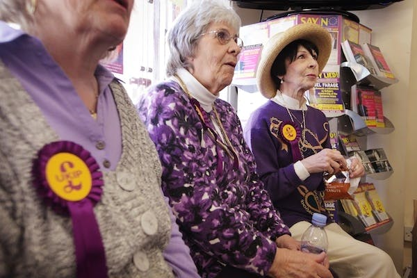 UKIP campaigners wait for their party leader Nigel Farage to arrive at an election event. The Tories were today advised to seek a pact in 2015 with the party. Picture: Getty