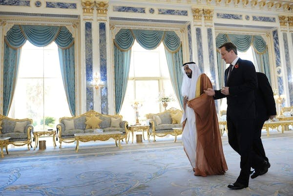 David Cameron is welcomed to the Al Rawda Palace in the city of al Ain in Abu Dhabi by the President of the UAE HH Sheikh Khalifa bin Zayed al Nahyan. Picture: Press Association