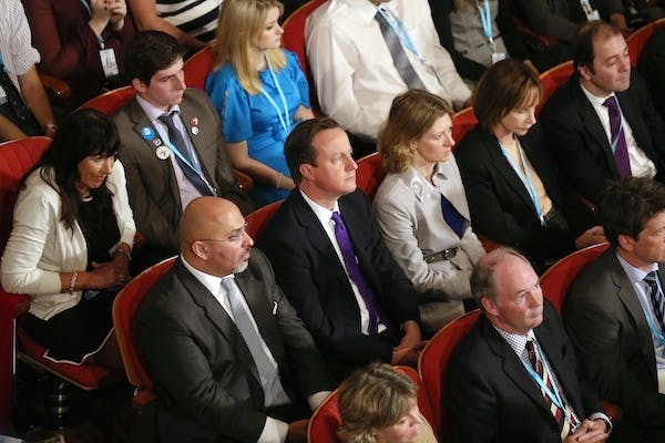 David Cameron flanked by loyal Conservative MPs at the party conference. Picture: Getty