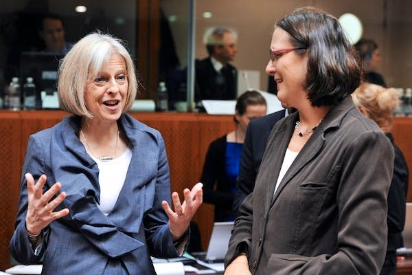 Theresa May and EU commissioner for Home Affairs Cecilia Malmstroem talk before a Justice and Home Affairs Council meeting today. Picture: Getty