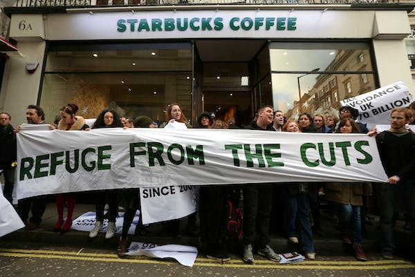 UK Uncut protesters outside a Starbucks in central London today. Picture: Getty