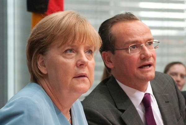 German Chancellor Angela Merkel with Gunther Krichbaum. The CDU member today warned Britain about the dangers of an EU referendum. Picture: Getty
