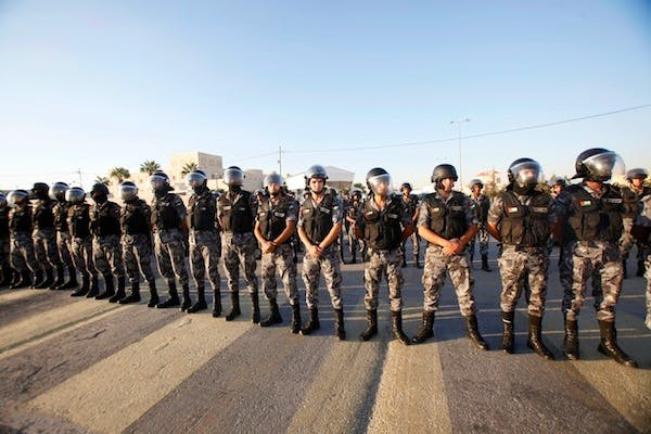 Jordanian anti-riot police guard the American embassy in Amman in 2011. Picture: Getty