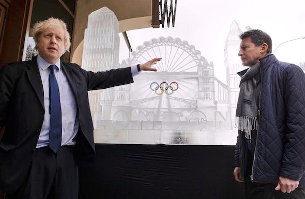 Boris Johnson next to an ice sculpture representing London 2012 in Davos. Picture: Getty