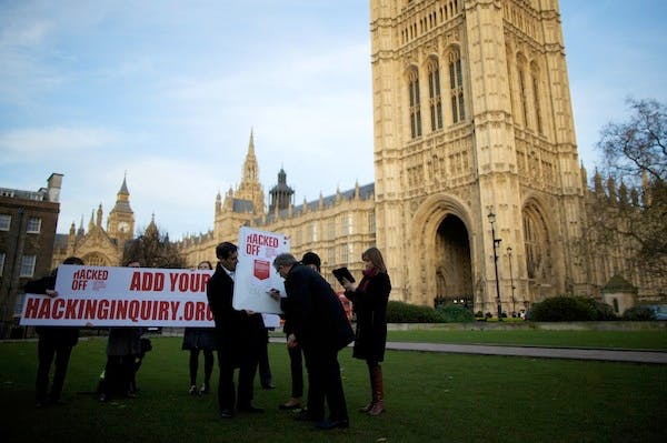 Members of the Hacked Off Campaign stage a photocall outside Parliament. Picture: Getty