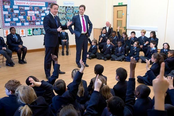 David Cameron and Nick Clegg on a visit to a school. This week the Coalition didn't do a great job at marking its own homework. Picture: Getty