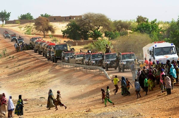 Troops enter Ansongo, a town south of the northern Malian city of Gao. Picture: Getty