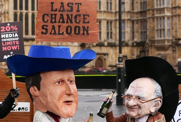 Press reform campaigners hold a rally outside parliament. Picture: Getty