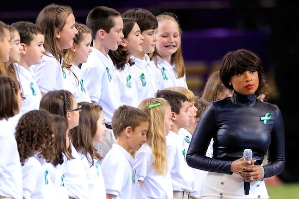 Singer Jennifer Hudson performs 'America The Beautiful' with the Sandy Hook Elementary School Chorus prior to the start of Super Bowl. Picture: Getty