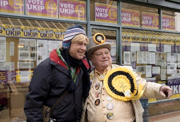 Michael Fabricant poses with the Monster Raving Loony Party candidate outside the UKIP campaign offices during the Eastleigh by-election. Picture: Getty