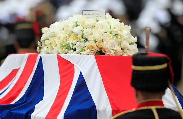 Cream and white flowers lie on top of Margaret Thatcher's coffin. Picture: Getty