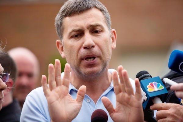 Ruslan Tsarni, the uncle of the suspected Boston Marathon bombing suspects, speaks to reporters in front of his home today. Picture: Getty
