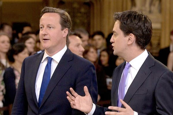 David Cameron and Ed Miliband chatting at the State Opening of Parliament today. Picture: Getty