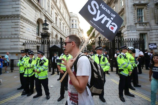 Protesters outside Downing Street this afternoon. Picture: Getty