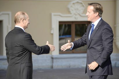 Vladimir Putin greets David Cameron at the G20 summit in St Petersburg. Picture: Getty