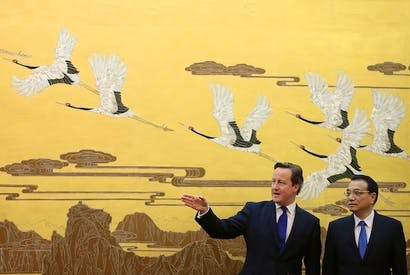 Chinese Premier Li Keqiang and David Cameron talk during a signing ceremony inside the Great Hall of the People. Picture: Getty