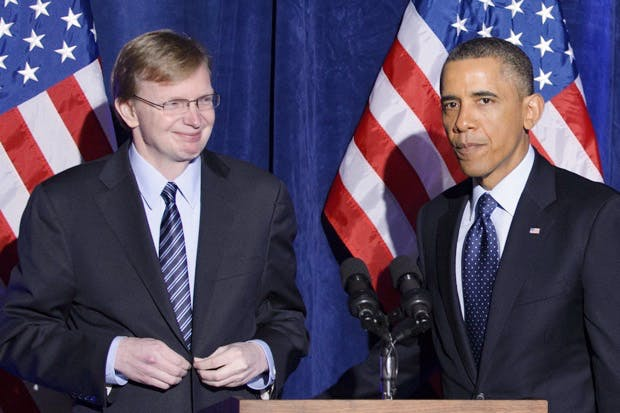 Barack Obama speaks as Organizing for Action head Jim Messina (L) looks on during an Organizing for Action dinner on March 13, 2013 at the St. Regis Hotel in Washington, DC.