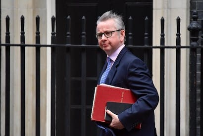 "Britain's Environment, Food and Rural Affairs Secretary Michael Gove leaves from 10 Downing Street in central London on March 20, 2018 after attending the weekly meeting of the Cabinet. Britain and the European Union on March 19 reached a landmark deal on a transition phase that will see London follow the bloc's rules for nearly two years after the Brexit divorce. Chief EU negotiator Michel Barnier and his British counterpart David Davis said the agreement, which European leaders will sign at a summit this week, was a ""decisive step"". (Photo: BEN STANSALL/AFP/Getty Images)"