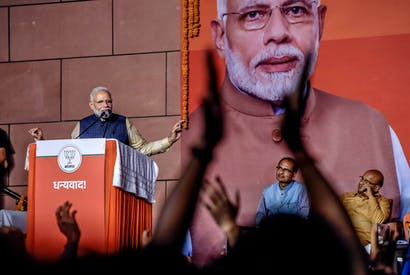 A victorious Narendra Modi addressing workers at this party's headquarters in New Delhi. (Photo by Atul Loke/Getty Images)
