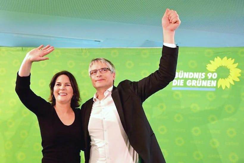 Germany's Greens cheer their party's results in the exit poll.